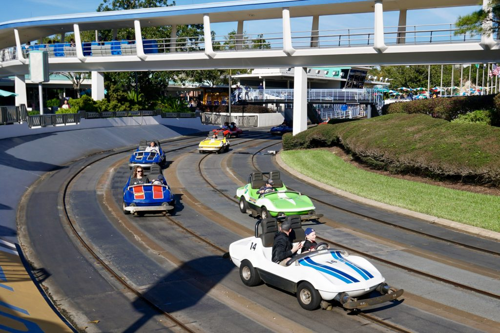 Image of cars driving on Disney's Tomorrowland speedway. Photo from magic guides dot com.